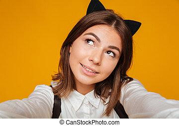Close up portrait of a cute teenage schoolgirl in uniform