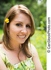 Close up portrait of a cute woman in field