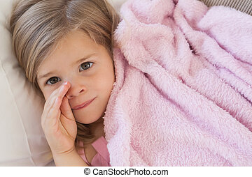 Close-up portrait of a cute young girl resting