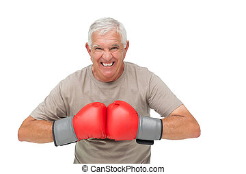 Close-up portrait of a determined senior boxer over white...