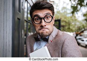 Close-up portrait of a funny nerd man wearing eyeglasses...