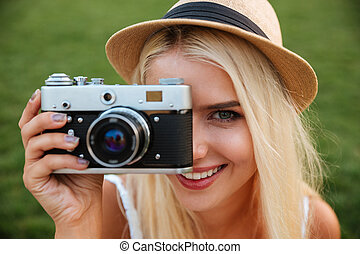 Close up portrait of a girl making photo with camera