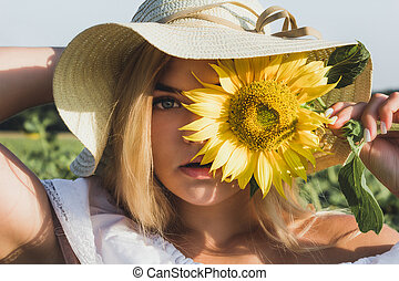 close-up portrait of a girl with a sunflower