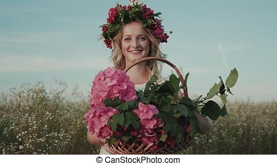 Close-up portrait of a girl with a wreath on her head and a basket of flowers