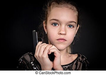 Close-up portrait of a girl with gun
