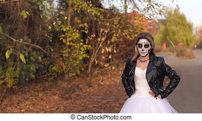 Close-up portrait of a gothic girl in a wedding dress and a creepy make-up.