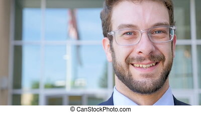 Close up portrait of a handsome businessman outside a modern office building
