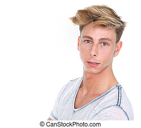 Close up portrait of a handsome young blond man looking at camera on isolated white background