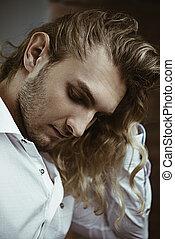 long curly blond hair