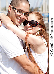 Close up portrait of a happy couple hugging