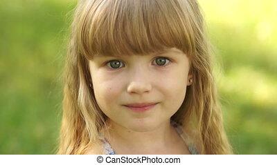 Close-up portrait of a happy girl e
