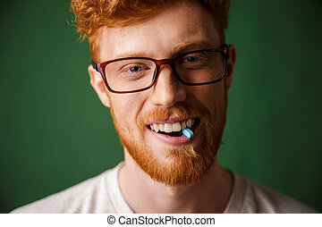Close up portrait of a happy redhead man in eyeglasses
