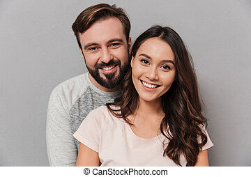 Close up portrait of a happy young couple hugging