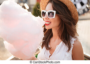 Close up portrait of a happy young girl in sunglasses