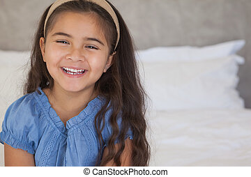 Close-up portrait of a happy young girl