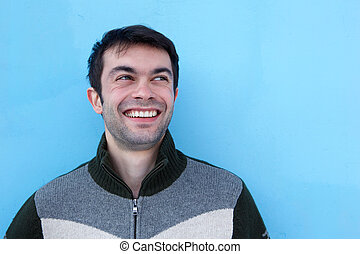 Close up portrait of a happy young man smiling