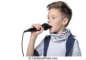 Close-up portrait of a little boy with microphone