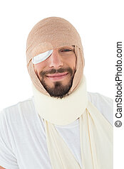 Close-up portrait of a man with head tied up in bandage