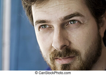 Close-up portrait of a masculine bearded guy