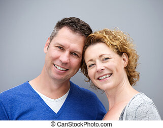 Close up portrait of a middle aged couple smiling