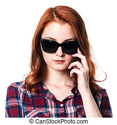 Close-up portrait of a pensive girl with dark glasses.