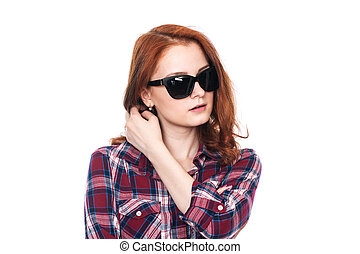 Close-up portrait of a pensive girl with dark glasses