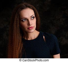 portrait of a pretty girl. Dark background