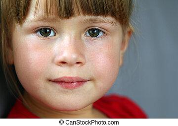 Close-up portrait of a pretty little girl