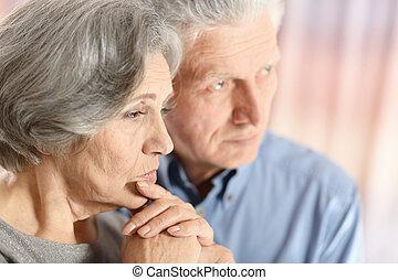 sad elder couple - Close-up portrait of a sad elder couple...