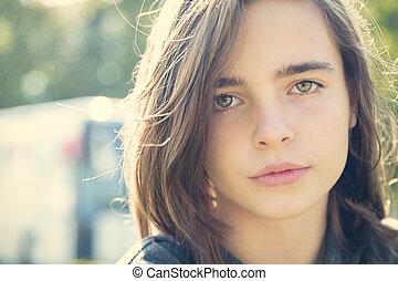 close up portrait of a sensitive female teenager
