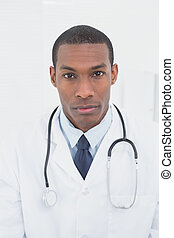 Close up portrait of a serious male doctor