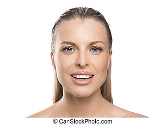 Close up portrait of a smiley woman over white background. Teeth whitening and face lifting concept