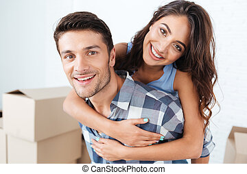 Close-up portrait of a smiling couple in new flat