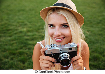 Close up portrait of a smiling girl with retro camera