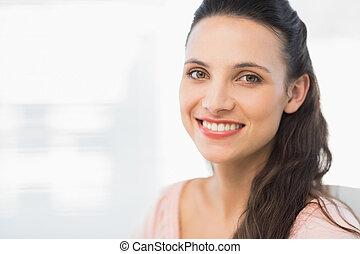 Close-up portrait of a smiling businesswoman