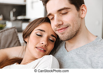 Close up portrait of a smiling young couple relaxing