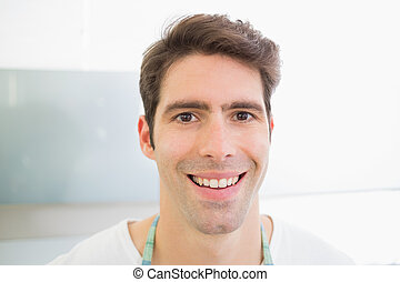 Close up portrait of a smiling young man