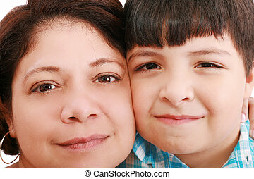 Close-up portrait of a smiling young mother and little son