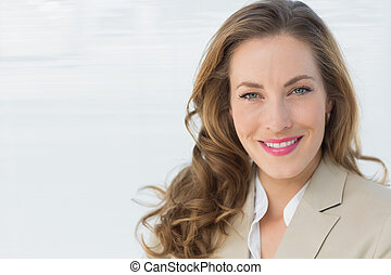 Close-up portrait of a smiling young businesswoman