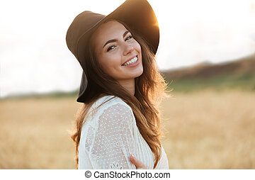 Close up portrait of a smiling young woman with long hair