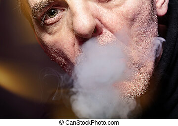 close up portrait of a smoking man