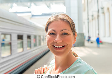 close-up portrait of a woman at the railway station