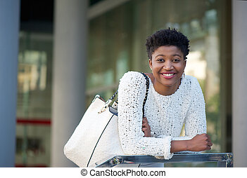 young african american woman smiling in the city