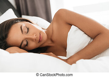 Close up portrait of a young beautiful asian woman sleeping...
