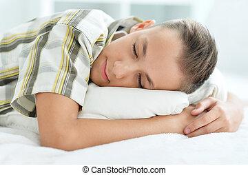 boy sleeping in bed