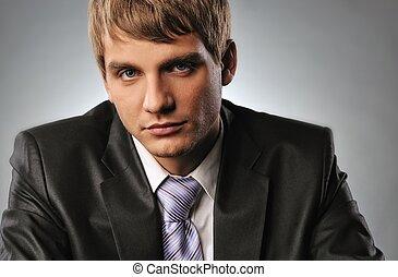 Close-up portrait of a young businessman