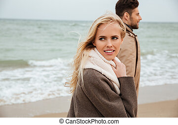 Close up portrait of a young couple in love walking
