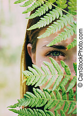 Portrait Of A Young Happy Beauty Red Hair Girl Woman Holding Fern Leaf Up To Face In Summer Park Forest