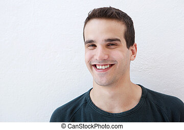 Close up portrait of a young latin man smiling