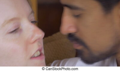 Close up portrait of a young mixed racial couple in love showing affection